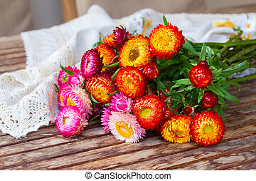 Bouquet of Everlasting flowers on table - Bouquet of fresh...