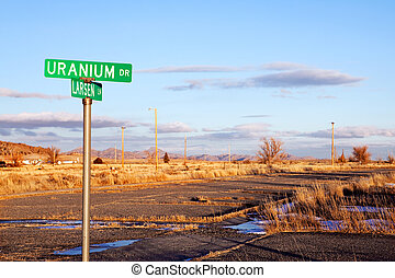 Uranium Drive with road in disrepair. Jeffrey City, Wyoming...