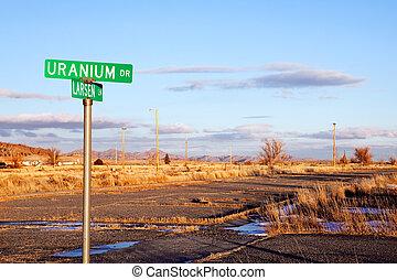 Uranium Drive with road in disrepair. Jeffrey City, Wyoming...