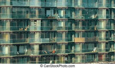Modern multistorey apartment block - Panning shot of modern...