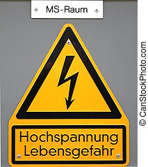 High Voltage - High voltage sign in Germany. The top line...