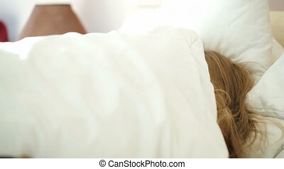 Woman hardly waking up in the morning