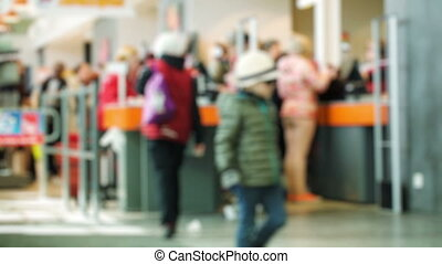Customers in the supermarket paying at ther cashdesk, other...