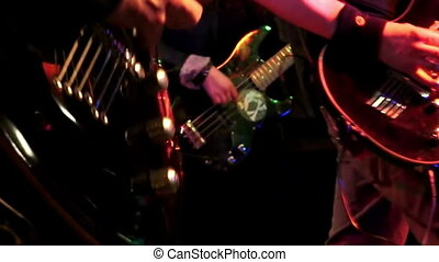 Rock band performing on stage - Guitarists performing on...
