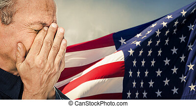 Veteran Portrait of an elderly man with face closed by hand...