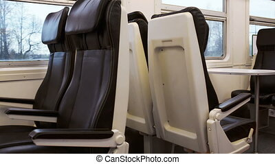 Empty black seats in moving express train
