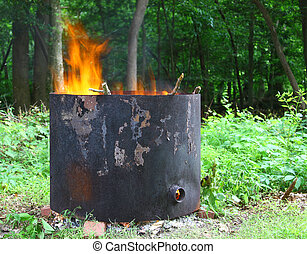 An old home made metal burn ring for burning tree stumps that have been left in the ground after the tree has been cut down