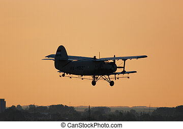 Old airplane at the sunset in the summer