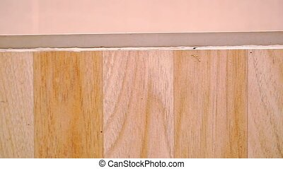 Close up of oak parquet of beige color. Macroo video shift...