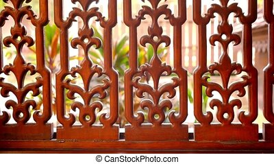 Beautiful wooden fence with ornaments Macro video shift...