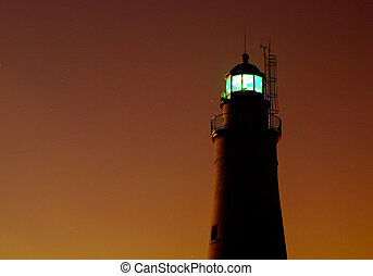 Moon Light - The Fort Gratiot Lighthouse silhouetted by the...