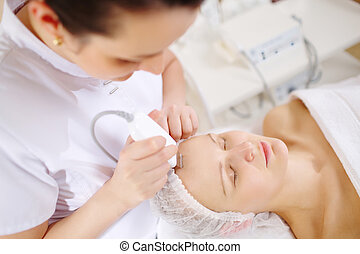Ultrasonic face cleaning at the beauty spa - Woman under the...