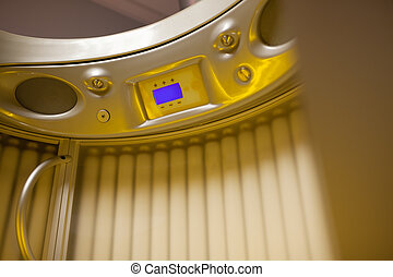 Stand up tanning system interior showing control panel