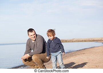 Father with his young son at the beach