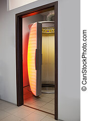 Stand up tanning bed - Empty stand up tanning bed in another...