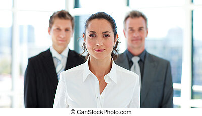 Beautiful businesswoman in front of her team - Beautiful...