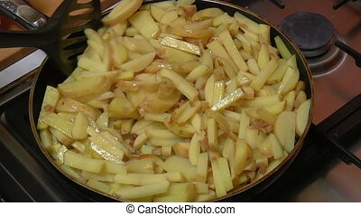 Frying Pan with Sliced Potatoes, closeup