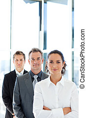 Matureusinessman in a line with his business team - Mature...