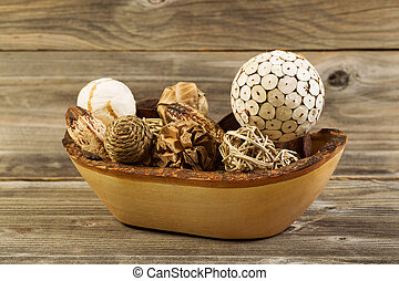 Traditional Wood Ornaments in Wooden Bowl on Rustic Wood -...