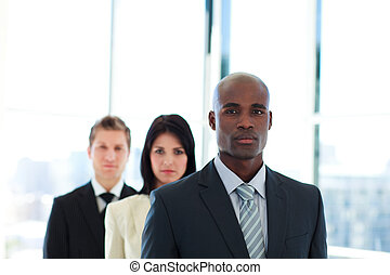 Serious African businessman leading his team in office
