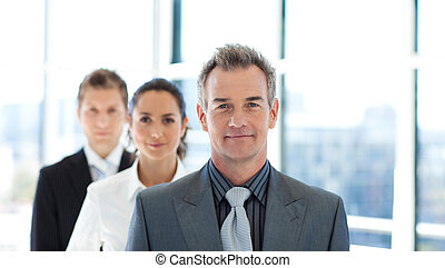 Friendly businessman leading a business team