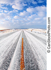 winter road with snow and ice, rural Wyoming