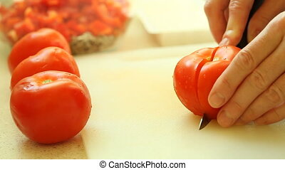 slicing with knife tomato vegetable - food hands of woman...