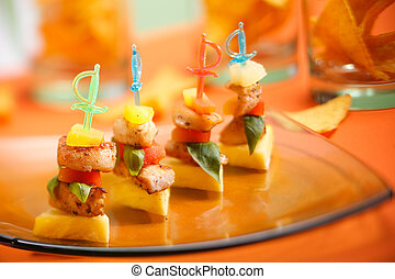 Party snack. Delicious chicken on a stick starter