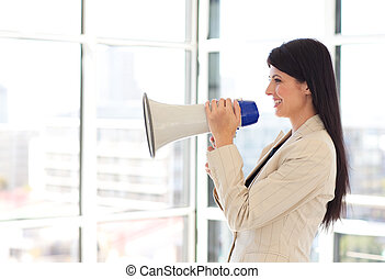 Businesswoman shouting through megaphone - Attractive...