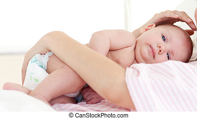 Newborn baby with his mother in bed - Newborn baby with his...