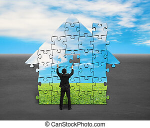 Assembling puzzles in house shape with blue sky background