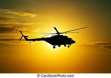 Helicopter at sunset in the sky