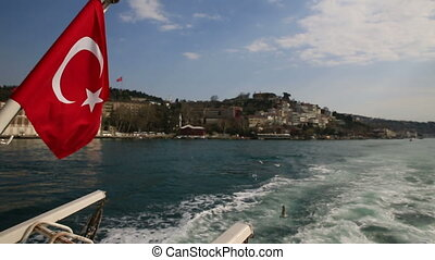 Navigating bosphorus in Turkey - Rear view of boat while...