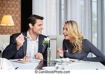 Couple eating dessert in a restaurant