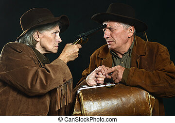 Wild west bandits - Two bandits with guns in the wild west