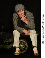 man smoking cigarette - Senior man smoking cigarette over...