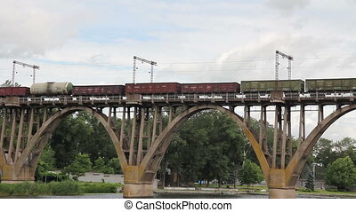 freight train going over the bridge - cars of a freight...