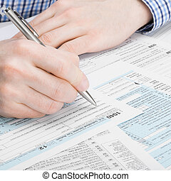 United States of America Tax Form 1040 - man performing tax...