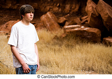 teen boy in nature - teen boy in Wyoming wilderness area,...