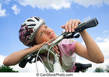 Bike girl looking at the sun - Healthy young girl with...