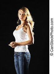 Young woman in jeans sideview