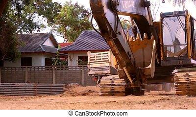KOH SAMUI, THAILAND - JUNE 21: Excavator rides in...