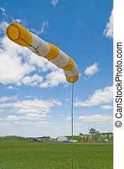 Windsock - Wind meter in little airdrome at blue sky as...