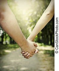 Couple holding hands - Lovers couple holding hands in a...