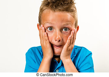 Surprised boy - Caucasian boy with a silly face. Studio shot...