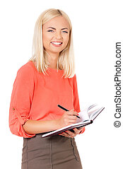 Young woman - Young happy female makes some notes in...