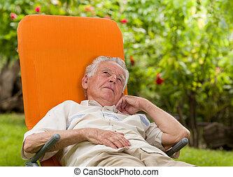 Man enjoying in sunbed - Conceived old man in sunbed in...