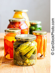 Vegetable preserves on wooden table