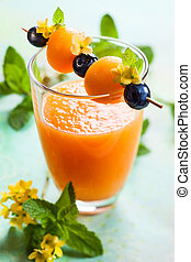 Melon smoothie with fruit skewer