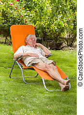 Senior man in sunbed - Old man resting in sunbed in his...